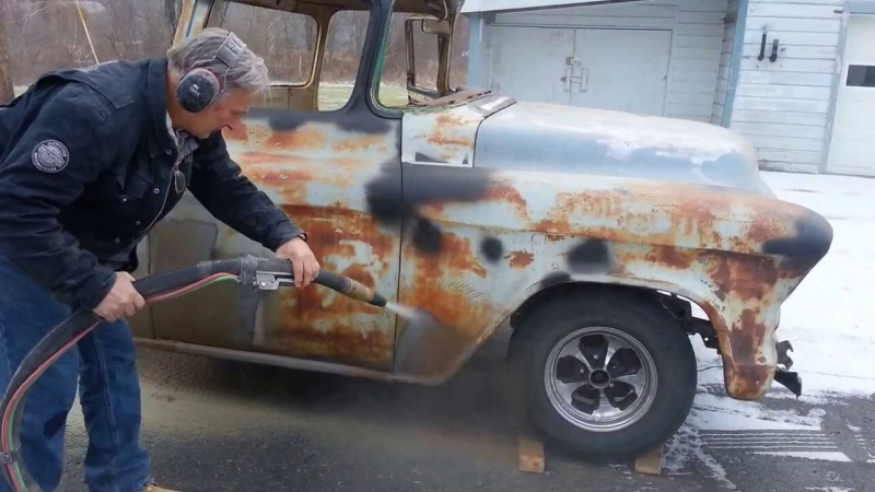Auto restoration by removing rust with sandblasting.