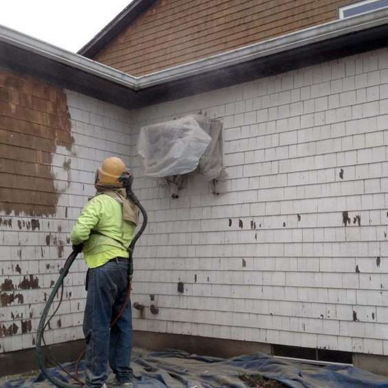 Stripping paint off of a wood house